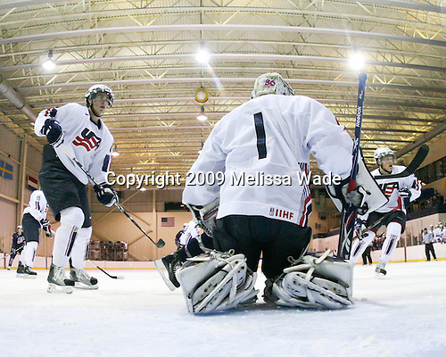 John Moore (US White - 8), Jack Campbell (US White - 1), Chris Wideman (US White - 5) - Team White defeated Team Blue 8-7 (OT) in their third scrimmage of the 2009 USA Hockey National Junior Evaluation Camp on Sunday, August 9, 2009, in the USA (NHL-sized) Rink in Lake Placid, New York.