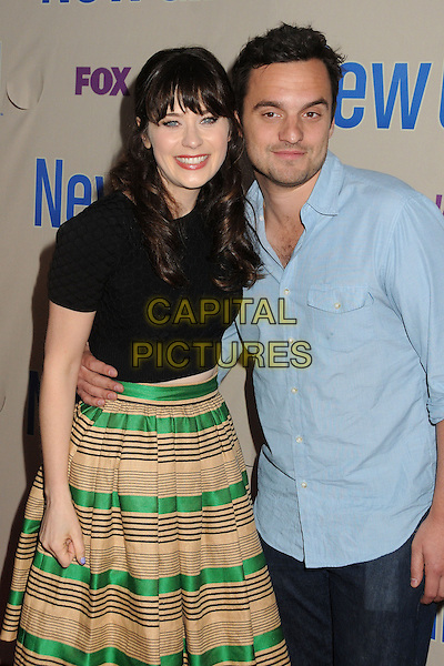 "Zooey Deschanel & Jake Johnson.""New Girl"" Screening and Q&A held at the Academy of Television Arts & Sciences..April 30th, 2013.half length black top beige gold green stripe skirt blue shirt.CAP/ADM/BP.©Byron Purvis/AdMedia/Capital Pictures"