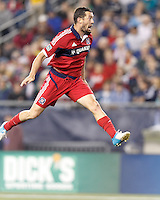 Chicago Fire defender Dan Gargan (3) goes for a header. In a Major League Soccer (MLS) match, the New England Revolution (blue) defeated Chicago Fire (red), 1-0, at Gillette Stadium on October 20, 2012.