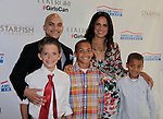 Irvin Mayfield and two sons Richie & Irvin and Soledad O'Brien & son Jackson at Soledad O'Brien as Starfish Foundation presents New Orleans to New York City 2014 Gala on July 24, 2014 at Espace, New York City for VIP Cocktail Reception, dinner, entertainment with Grammy Award winning Trumpeteer Irvin Mayfield (also Board president) and the New Orleans Jazz Orchestra. (Photo by Sue Coflin/Max Photos)