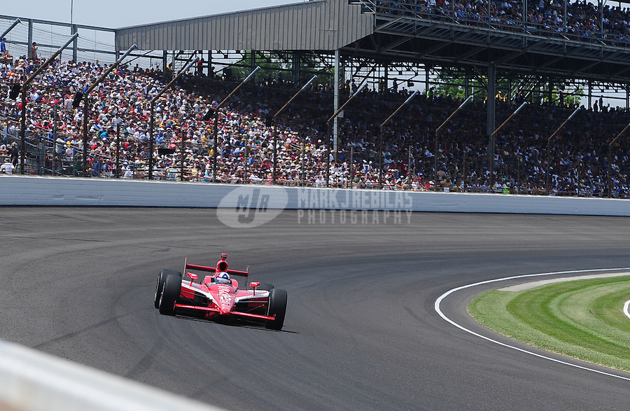 May 30, 2010; Indianapolis, IN, USA; IndyCar Series driver Dario Franchitti (10) during the Indianapolis 500 at the Indianapolis Motor Speedway. Mandatory Credit: Mark J. Rebilas-