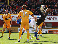 Darren randolph saves under strong pressure from Frazer Wright in the Motherwell v St Johnstone Clydesdale Bank Scottish Premier League match played at Fir Park, Motherwell on 28.4.12..