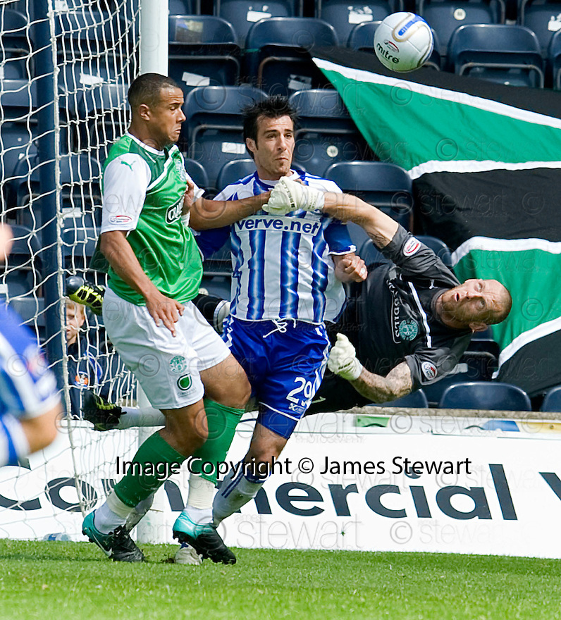 HIBERNIAN'S GRAHAM STACK PUNCHES CLEAR FROM KILMARNOCK'S MANUEL PASCALI