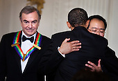 Singer Neil Diamond (L) waits as United States President Barack Obama (C) hugs musician Yo-Yo Ma during a Kennedy Center Honors reception in the East Room of the White House, Sunday, December 4, 2011 in Washington, DC.  For their accomplishments and contributions to the arts actress Meryl Streep, singer Neil Diamond, actress Barbara Cook, musician Yo-Yo Ma, and musician Sonny Rollins where etched recognized as this year's recipients of the Kennedy Center Honors..Credit: Brendan Smialowski / Pool via CNP