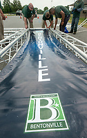NWA Democrat-Gazette/BEN GOFF @NWABENGOFF<br /> Staff from Bentonville Parks and Recreation assemble the finish line structure Friday, June 8, 2018, for the Memorial Park Glow Run. The two-mile run starting at 8:45 p.m. kicks off the Bentonville Parks and Recreation 2018-19 Run Bentonville Race Series. Participants receiver glow-in-the-dark race shirts, Energizer headlamps and other 'glow gear' for the after dark race.