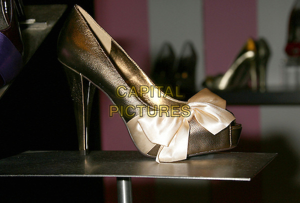 ATMOSPHERE .Paris Hilton debuts her new fall shoe line of Paris Hilton Footwear at Macy's Fashion Show Mall, Las Vegas, Nevada, USA..July 29th, 2008.gv g.v. general view gold heel cream silk satin bow .CAP/ADM/MJ.©Michael Jade/AdMedia/Capital Pictures.