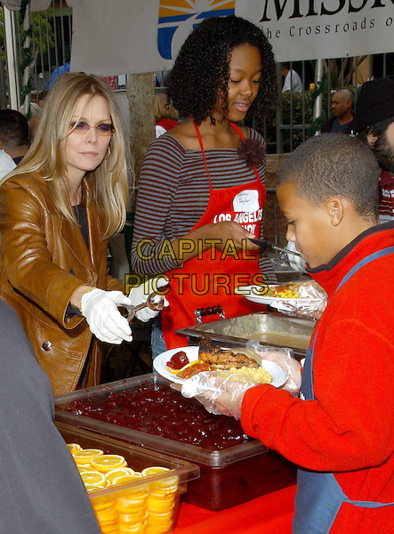 MICHELLE PFEIFFER.volunteer as The Los Angeles Mission Serve Up Holiday Cheer for the Homeless of Skid Row in Downtown Los Angeles, California on Christmas Eve .24 December 2003  .**UK Sales Only**  .food    .www.capitalpictures.com.sales@capitalpictures.com.©Capital Pictures.