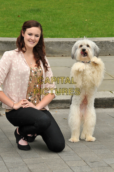 Ashleigh Butler & Pudsey the dog unveil new PETA ad in Westminster. Britain's Got Talent stick up for wild animals who are forced to perform and made to suffer in the circus industry.  Ashleigh Butler and her canine sidekick Pudsey appear in hard-hitting new anti-circus ad.  The Old Palace Yard, Palace of Westminster, Westminster, London, England..June 21st, 2012.full length black jeans denim cream top beige print shirt dog animal pet standing trick kneeling .CAP/BF.©Bob Fidgeon/Capital Pictures.