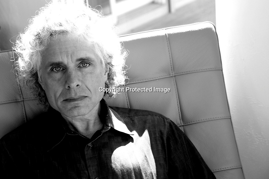 "Steven Pinker, Harvard Professor and Johnstone Family Professor in the Department of Psychology at Harvard University, is photographed at his ocean-front home in Truro, MA. Pinker is best known for his research on language and cognition, and how they've evolved in humans over time. His new book proports that  contrary to popular belief, there has been a steady decline in violence since the beginning of civilization. ""Believe it or not, we may be living in the most peaceful era of our species' existence,"" Pinker says of his research. 9/16/11 Julia Cumes"