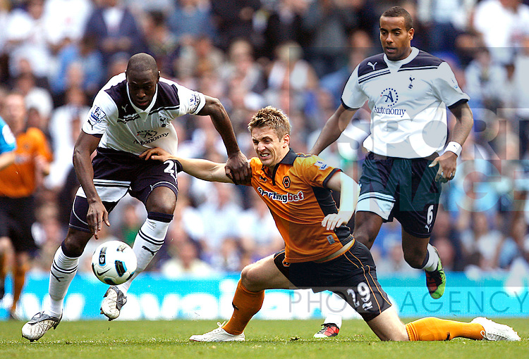 Ledley King of Tottenham Hotspur and Kevin Doyle of Wolverhampton Wanderers fight for the ball