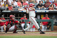 Arkansas Razorbacks catcher Casey Optiz (12) follows through on his swing during Game 5 of the NCAA College World Series against the Texas Tech Red Raiders on June 17, 2019 at TD Ameritrade Park in Omaha, Nebraska. Texas Tech defeated Arkansas 5-4. (Andrew Woolley/Four Seam Images)