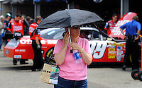 May 31, 2008; Dover, DE, USA; A Nascar Sprint Cup Series fan walks through the garage during a rain delay in practice for the Best Buy 400 at the Dover International Speedway. Mandatory Credit: Mark J. Rebilas-US PRESSWIRE