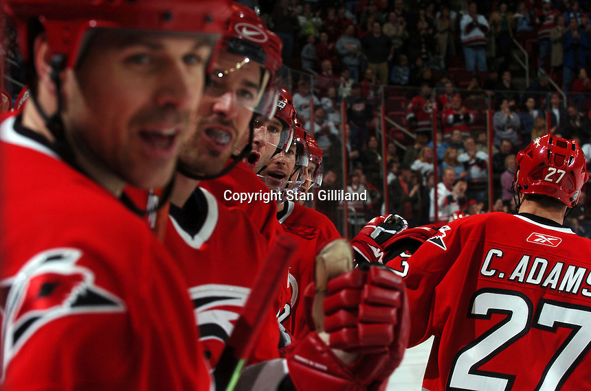 Carolina Hurricanes' Craig Adams (27) is congratulated by teammates Doug Weight, Justin Williams, Erik Cole, and Matt Cullen after his third period goal against the Florida Panthers Friday, March 3, 2006 at the RBC Center in Raleigh, NC. Carolina won 5-2.