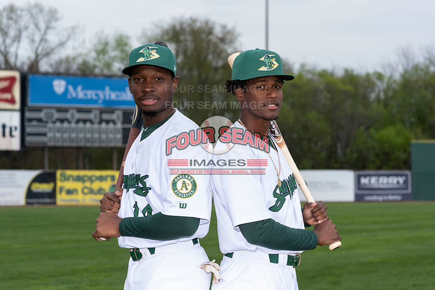 Beloit Snappers outfielder Lester Madden (14) and infielder Marcos Brito (6) pose for a photo before a Midwest League game against the Lake County Captains at Harry C. Pohlman Field on May 8, 2019 in Beloit, Wisconsin. (Zachary Lucy/Four Seam Images)