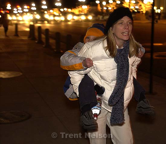 Salt Lake City - Laura Nelson and Noah Nelson looking at Christmas lights downtown. 12.29.2002, 8:01:24 PM<br />