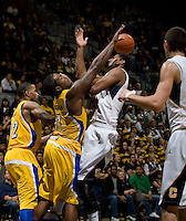 Christian Behrens of California fights for a loose ball against Mo Hughley of CSUB during the game at Haas Pavilion in Berkeley, California on November 11th, 2012.  California defeated CSUB, 78-65.