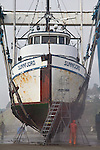 Port Townsend, Boat Haven, seiner, Sunnfjord, hauled out by a Marine Treavelift, scouring the hull, Port of Port Townsend, boatyards, Jefferson County, Olympic Peninsula, Puget Sound, Washington State, Pacific Northwest, USA,