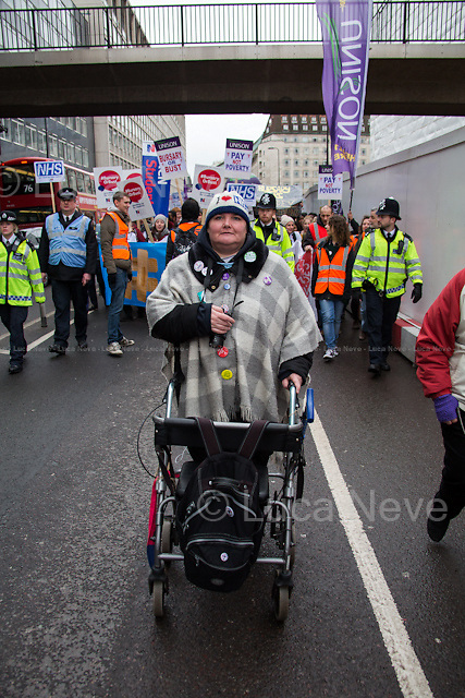 Paula Peters (Member of Disabled People Against Cuts, DPAC).<br /> <br /> London, 09/01/2016. Today, about 5,000 people, including doctors, student nurses, midwives, junior doctors and other healthcare professionals marched from the Saint Thomas Hospital to Downing Street to protest against the Conservative Government's plan to scrap bursaries for nursing and midwifery students from 2017. The demonstration was organised by the King's College London students and supported by trade unions and other organizations fighting against the plan to privatise the NHS (National Health Service).<br />  <br /> For more information please click here: http://on.fb.me/1IWbWg9<br /> <br /> To sign the online petition please click here: https://petition.parliament.uk/petitions/113491