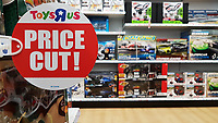 Pictured: A Price Cut sign in the Toys R Us store in Swansea, Wales, UK. Wednesday 28 February 2018<br /> Re: Toys R Us have announced that they are in administration by Moorfields.