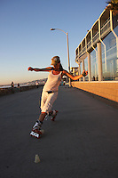Elese Coit dances through a set of cones on her in-line skates near Pacific Beach Drive in San Diego California just before sunset, Wednesday November 14 2007.   The unusually fine weather early this week brought crowds to the beach and the boardwalk.