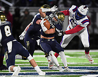 NWA Democrat-Gazette/CHARLIE KAIJO Arkadelphia High School defensive lineman Lorenzo Lawson (63) tackles Shiloh Christian High School Micah Button (7) during a Class 4A semi-final playoff football game, Saturday, December 1, 2018 at Champions Stadium at Shiloh Christian High School in Springdale.