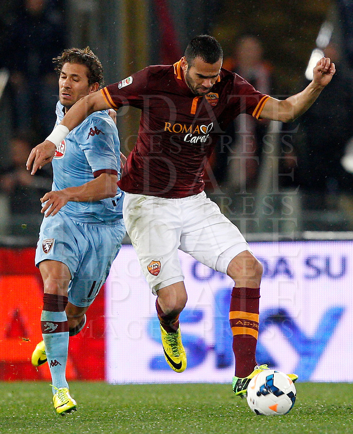 Calcio, Serie A: Roma vs Torino. Roma, stadio Olimpico, 25 marzo 2014.<br /> AS Roma defender Leandro Castan, of Brazil, is challenged by Torino midfielder Alessio Cerci, left, during the Italian Serie A football match between AS Roma and Torino at Rome's Olympic stadium, 25 March 2014.<br /> UPDATE IMAGES PRESS/Riccardo De Luca