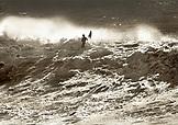 USA, California, man navigating large waves on his surfboard, Davenport (B&W)