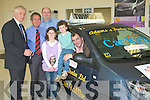 Mark Hanley of the rose of Tralee presents a Renault Twingo to Rose of Tralee Car raffle winner Michael Cahill with his children Brian and Chloe, Glenbeigh at adams Garage Tralee on Thursday also in Photo are Mike Geoghegan and Noel O'Connor of Adams Tralee.