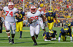 University of Wisconsin running back Montee Ball breaks away from the University of Michigan defense in the second quarter of a Big Ten Conference game at Michigan Stadium in Ann Arbor, MI on November 20, 2010. Ball rushed for 173 yards and four touchdowns in the game. (Photo by Bob Campbell)