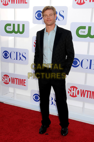Trevor Donovan.CBS, CW, Showtime 2012 Summer TCA Party held at The Beverly Hilton Hotel, Beverly Hills, California, USA..July 29th, 2012.full length suit hands in pockets black blue shirt .CAP/ADM/BP.©Byron Purvis/AdMedia/Capital Pictures.