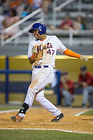 Gregory Valencia (47) of the Kingsport Mets grimaces in pain after fouling a ball off his foot during the game against the Elizabethton Twins at Hunter Wright Stadium on July 9, 2015 in Kingsport, Tennessee.  The Twins defeated the Mets 9-7 in 11 innings. (Brian Westerholt/Four Seam Images)