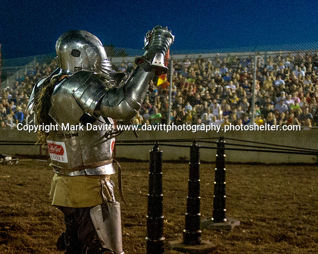 The Warren County Fair grandstand got very medieval July 27 when the nationally-known Knights of Valour performed a jousting tournament for a nearly packed house. After being knocked to the ground, the knight gets to his feet and wave to an appreciative crowd.