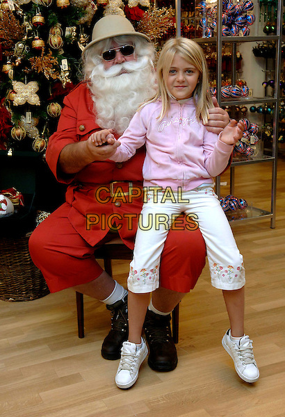 "SANTA CLAUS & LAURA FINN.At the opening of ""Christmas World"" at Harrods, London, UK..August 8th, 2006.Ref: FIN.full length tree sitting on knee safari.www.capitalpictures.com.sales@capitalpictures.com.©Steve Finn/Capital Pictures."