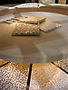 Custom Poseidon table top in creams honed and pillowed with Cosmos floor