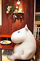 Tokyo, Japan - A huge plush Moomin character sits on the table with a customer at the Moomin House Cafe in TOKYO SKYTREE on June 17, 2014. There are three Moomin Cafe in Japan, serving food and desserts in the form of the Finnish character. This year is the 100th anniversary of the birth of their creator Tove Jansson (1914 - 2001). (C) Moomin CharactersTM. (Photo by Rodrigo Reyes Marin/AFLO)