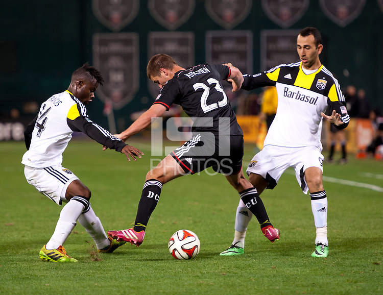 Perry Kitchen (23) of D.C. United fights for the ball between Waylon Francis (14) and Justin Meram (9) of the Columbus Crew celebrates his goal during a MLS game at RFK Stadium in Washington, DC.  D.C. United lost to the Columbus Crew, 3-0.