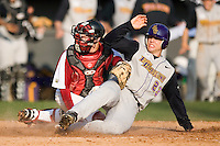 Drew Schieber (23) of the East Carolina Pirates slides into home plate ahead of the tag by Kyle Enders (18) of the South Carolina Gamecocks at Sarge Frye Field in Columbia, SC, Sunday, February 24, 2008.