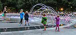 Guests frolic in the new water fountain at the Polk Brothers Park near Navy Pier Saturday, July 16, 2016. The newly designed water feature is park of the renovations at the Great Lakes biggest tourist attraction. (DePaul University/Jamie Moncrief)