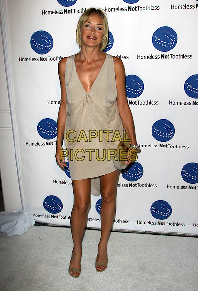 SHARON STONE .A Smile For Every Child Gala held At Shangri-La Hotel, Santa Monica, California, USA..September 10th, 2009.full length shoes gold beige sleeveless dress clutch bag grey gray low cut neckline draped open toe.CAP/ADM/KB.©Kevan Brooks/AdMedia/Capital Pictures.