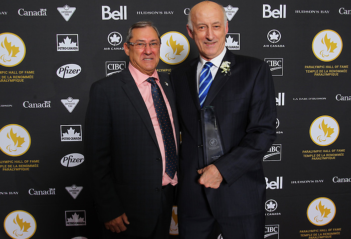 Ottawa, ON – Nov 27 2015 –Donald Royer and a friend pose for a photo at the Canadian Paralympic Hall of Fame in Ottawa, Ontario Nov 27, 2015. Royer was inducted into the Hall of Fame in the builder category. Photo Andre Forget / Canadian Paralympic Committee