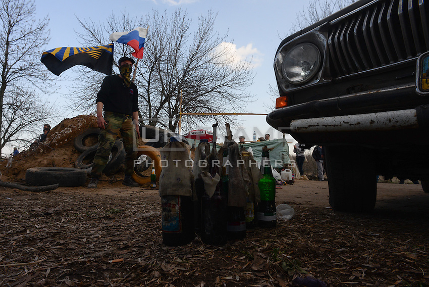 Pro-russian activists at the the gate to the airport of Kramatorsk where anti-terrorist operation takes place prepare for the assault at the airport of the Kramatorsk taken by ukrainian soldiers during anti-terroris operation