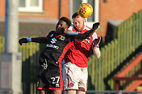 Ike Ugbo of MK Dons and Cian Bolger of Fleetwood Town in an aerial battle  during the Sky Bet League 1 match between Fleetwood Town and MK Dons at Highbury Stadium, Fleetwood, England on 24 February 2018. Photo by David Horn / PRiME Media Images