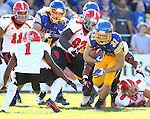 BROOKINGS, SD - OCTOBER 25:  Zach Zenner #31 from South Dakota State University looks for running room as Julius Childs #1 from Youngstown State defends in the first quarter of their game Saturday afternoon at Coughlin Alumni Stadium in Brookings. (Photo by Dave Eggen/Inertia)
