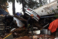 Pictured: A fireman assesses the damage.<br /> Re: Five people have reportedly died and severe damage caused by heavy rain and flash flooding in the area of Mandra, near Athens, Greece. Wednesday 15 November 2017