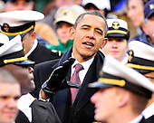 United States President Barack Obama speaks as he watches the 112th meeting of the United States Army Black Knights and the U.S. Navy Midshipmen on the Navy side of the field at FedEx Field in Landover, Maryland on Saturday, December 10, 2011..Credit: Ron Sachs / CNP
