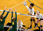 BROOKINGS, SD - SEPTEMBER 24: Payton Richardson #11 from South Dakota State looks to get a kill past Erika Gelzinyte #14 and Bella Lien #8 from North Dakota State during their match Sunday evening at Frost Arena in Brookings. (Photo by Dave Eggen/Inertia)
