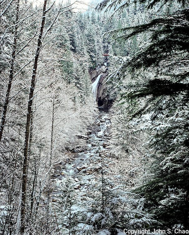 Lower Twin Falls & South Fork Snoqualmie River flow through a frosted winter forest in Olallie State Park, Washington State.