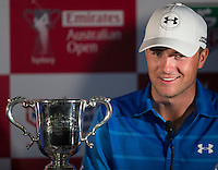Jordan Spieth of the USA talks to the press after winning the Emirates Australian Open Golf