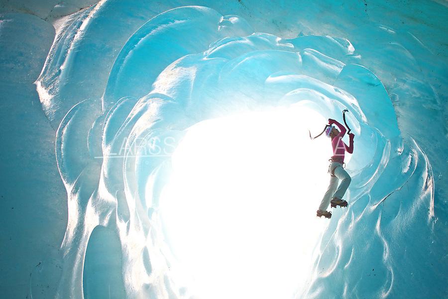 Stephanie Maureau climbing in an ice cave under the Mer de Glace glacier, France