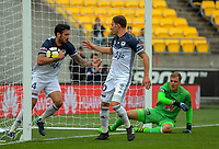 Rhys Williams (left) celebrates Victory's second goal equaliser during the A-League football match between Wellington Phoenix and Melbourne Victory at Westpac Stadium in Wellington, New Zealand on Sunday, 3 December 2017. Photo: Dave Lintott / lintottphoto.co.nz